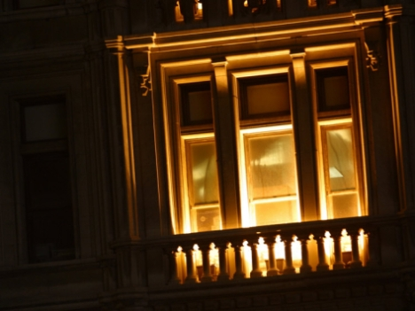 lights-glowing-through-tall-windows-and-balcony-at-night-in-new-york-city_i-G-36-3610-5X7EF00Z